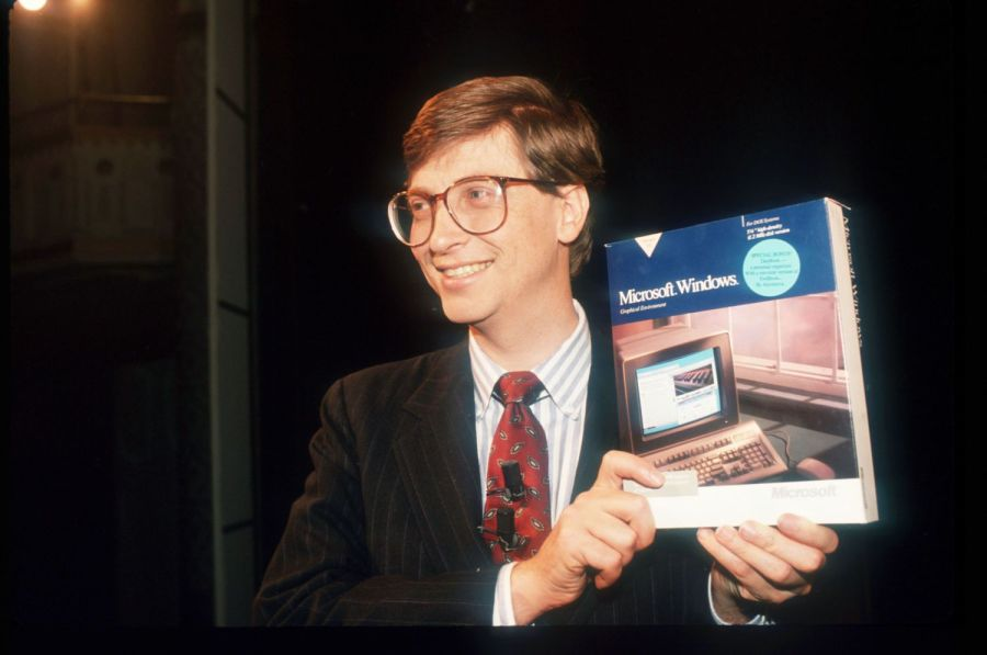 Here is Bill Gates holding a boxed copy of Windows 1.0